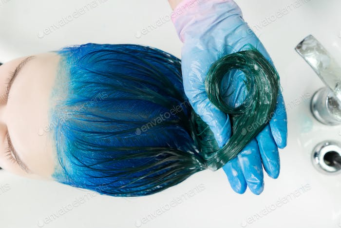 Top View of Hairstylist in Washes Long Hair Sapphire Color Hair with Shampoo