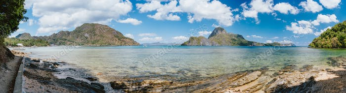 Palawan, Philippines. Panoramic picture of El Nido bay on summer sunny day. Picturesque coastline