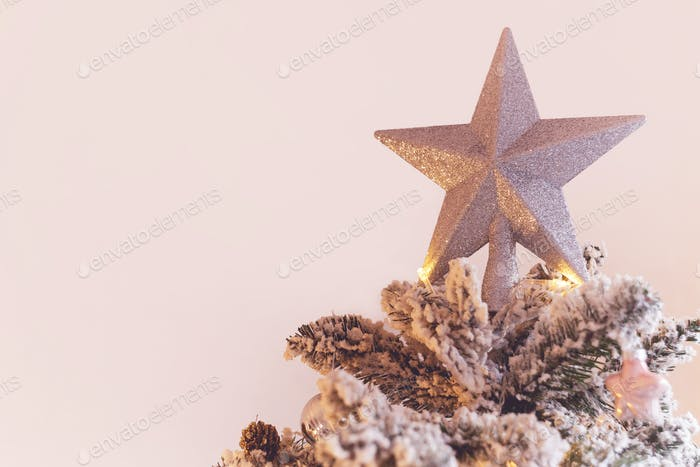 Decorative star on top of christmas tree
