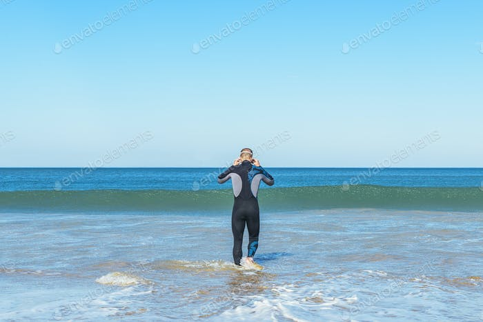 swimmer ready to go swimming in the sea