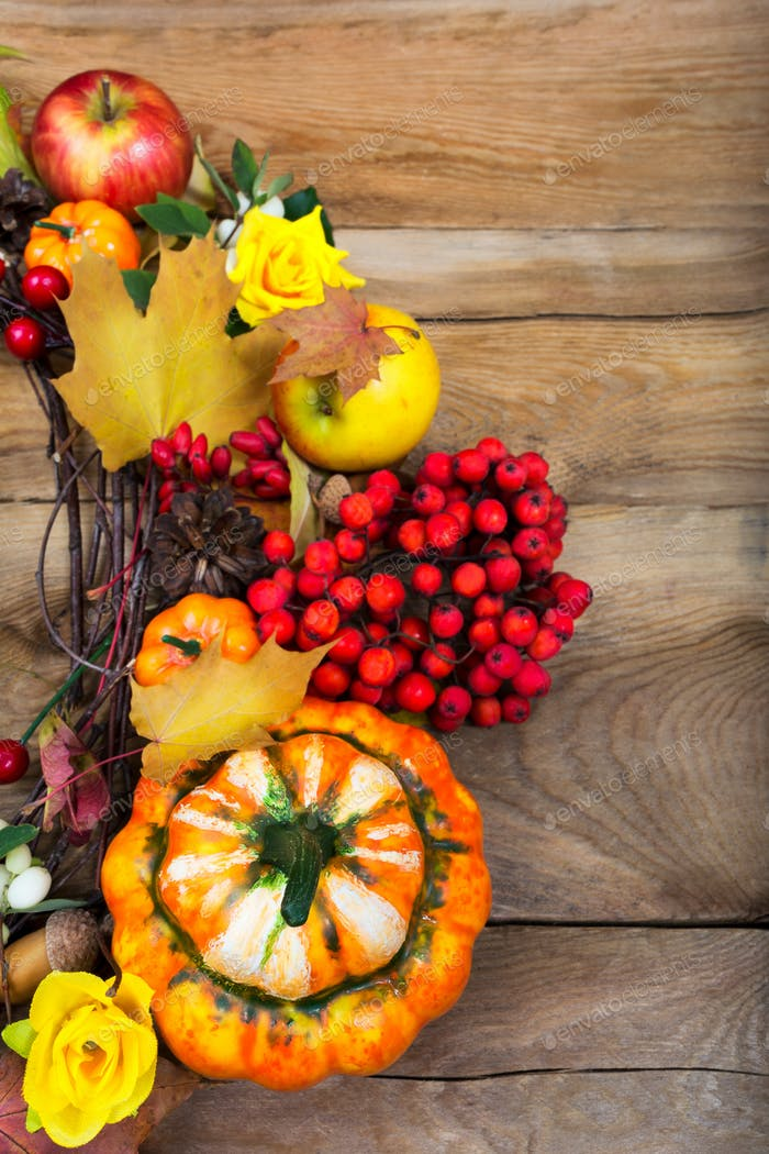 Harvest background with decorative pumpkin on the wooden table,
