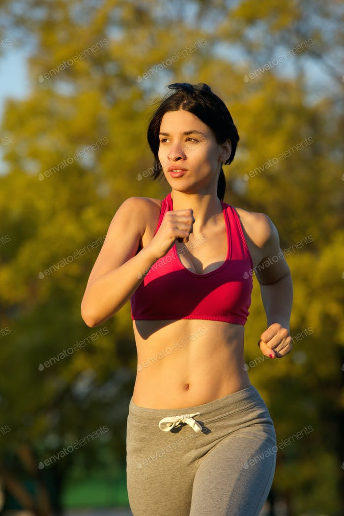 Fit young lady jogging in the park