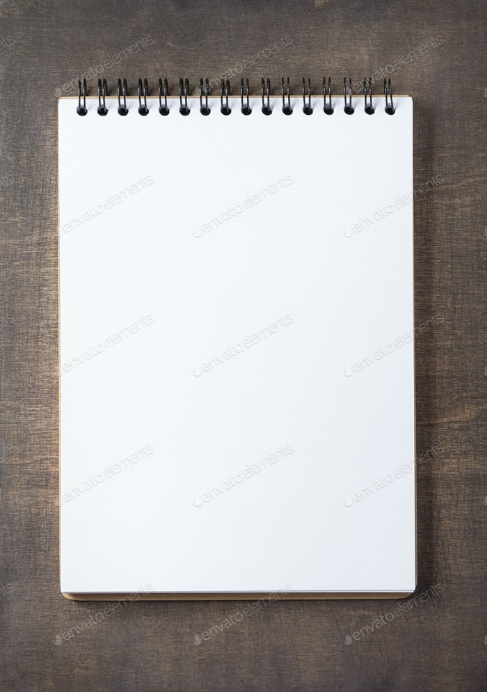 notepad at wooden background surface table