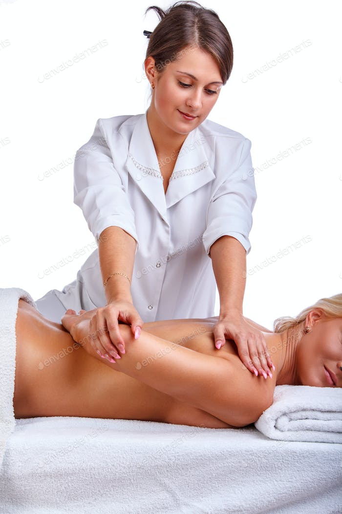 Female enjoing hand massage in therapist centre.