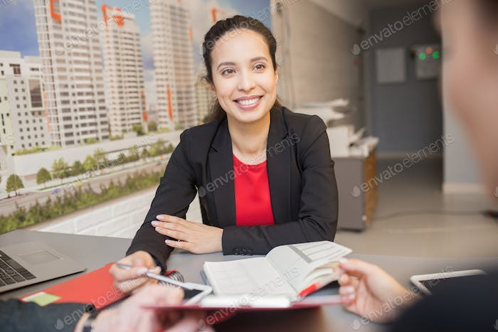 Mixed Race Businesswoman Meeting with Client