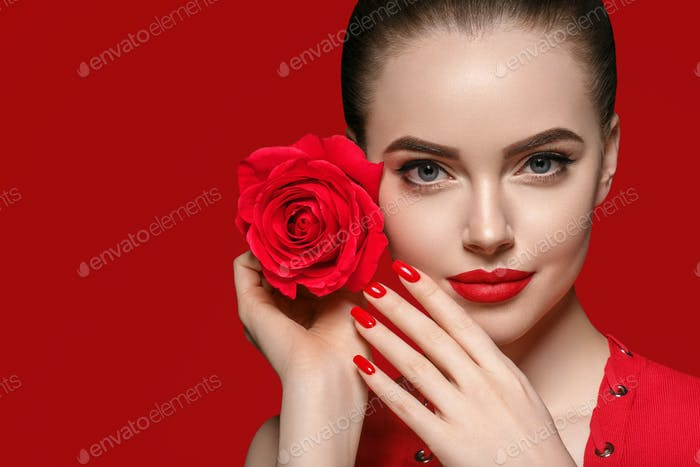 Woman with rose flower. Beauty female portrait with beautiful rose flower and salon hairstyle
