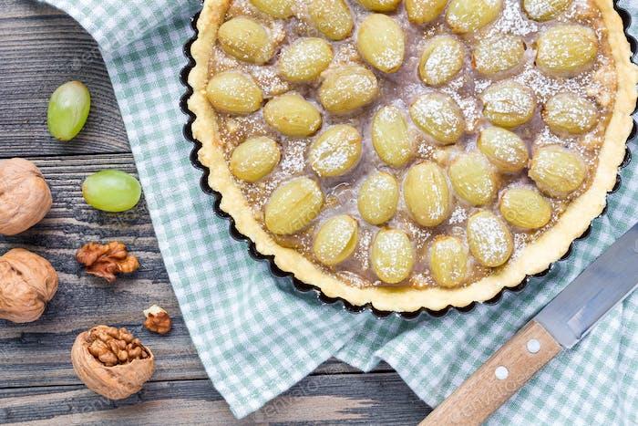 Shortbread dough grape tart with walnut praline, top view, horizontal