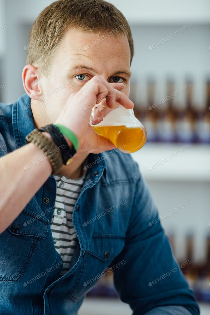 Portrait of man drinking beer