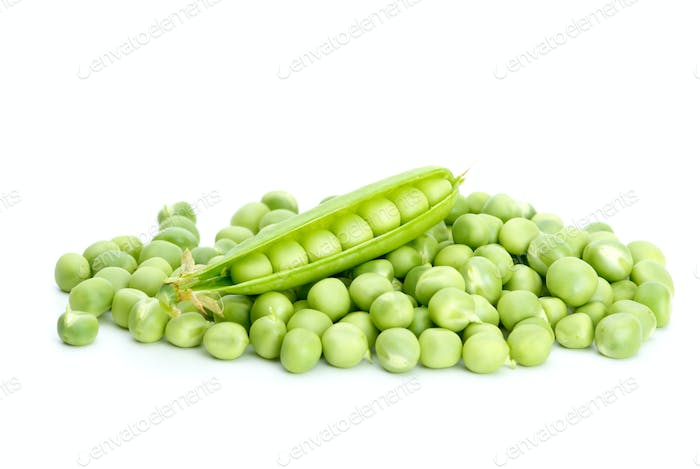 Cracked pod over pile of green peas