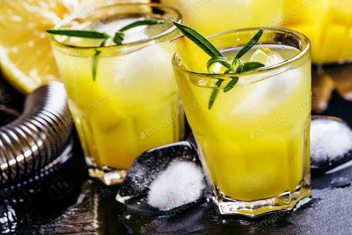 Alcoholic cocktail, mango rum collins, with syrup, lemon juice, ginger ale and ice