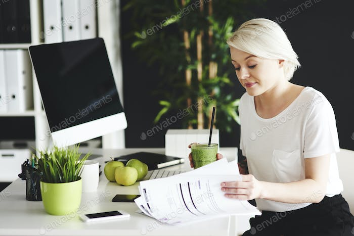 Business person reading important documents at her desk