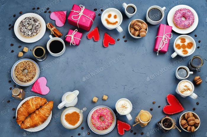 Stone background with cups of coffee, donuts, gift and hearts