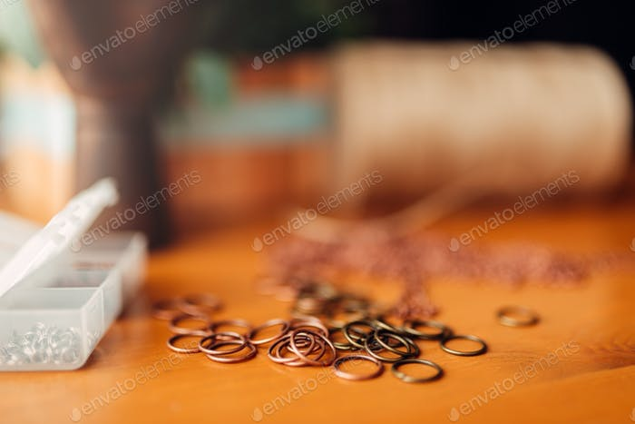 Metal rings on wooden table, closeup, needlework