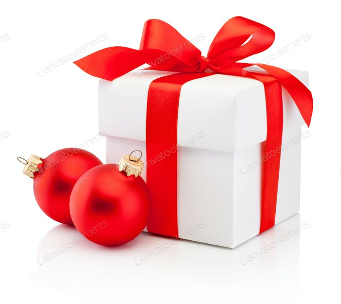 White gift box tied red ribbon bow and two Christmas bauble Isol