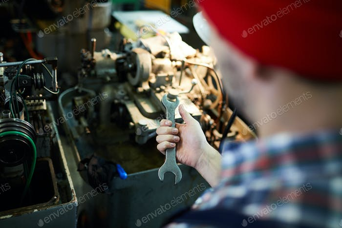 Unrecognizable Mechanic Holding Wrench