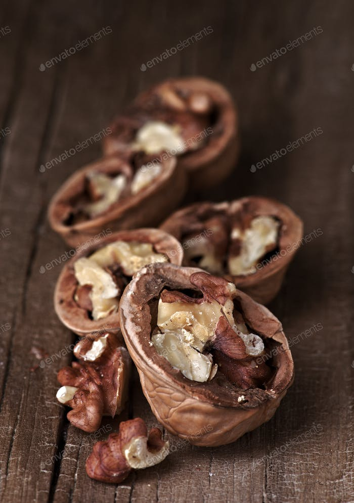 group of nuts on natural wood board