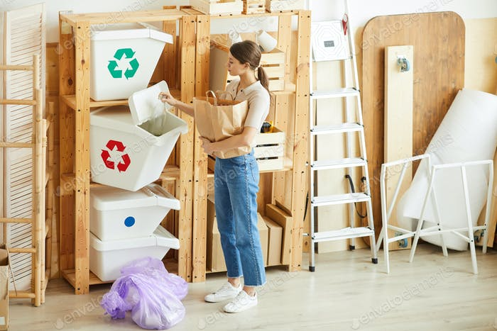 Woman sorting waste in bins