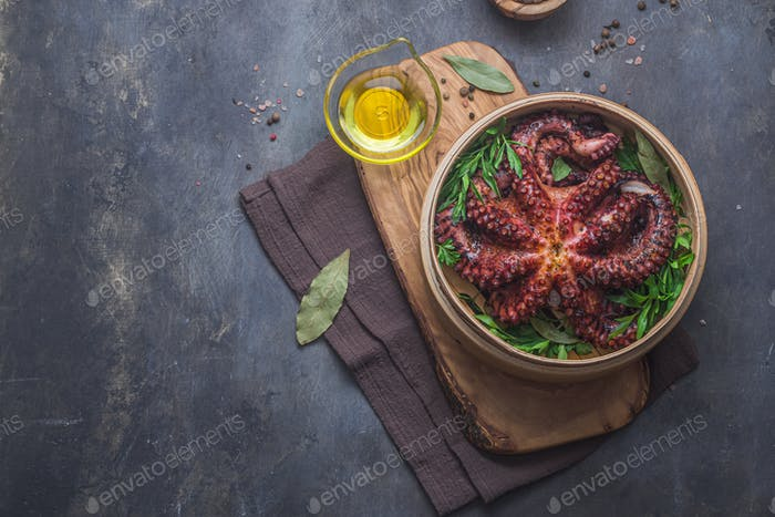 Whole steamed octopus with parsley and spices, copy space