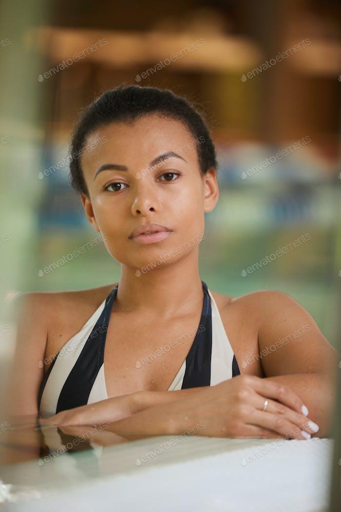Beautiful Mixed-race Woman in Swimming Pool