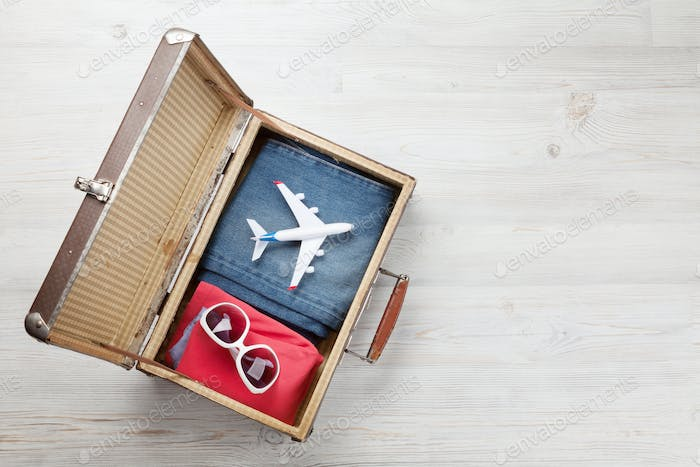 Suitcase, airplane, clothes and travel accessories
