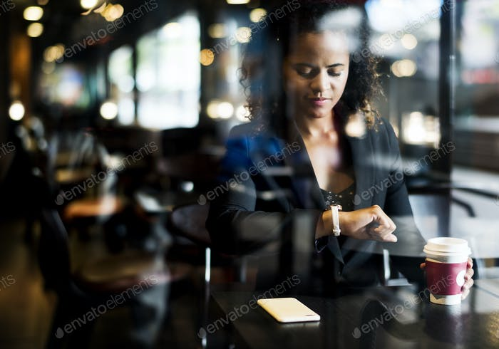 Woman waiting at a cafe
