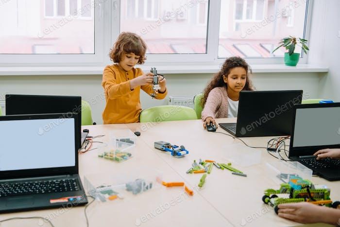 group of kids learning together, stem education concept