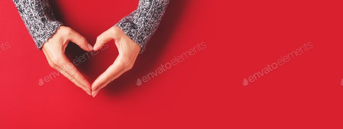 Red Banner with Female's Hands in Shape of Heart.