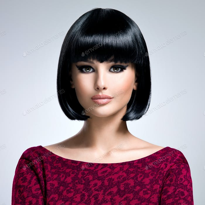 Beautiful brunette woman with bob hairstyle.