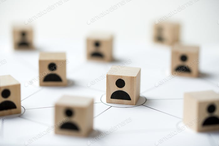 Social media network concept using icon people wooden cube block