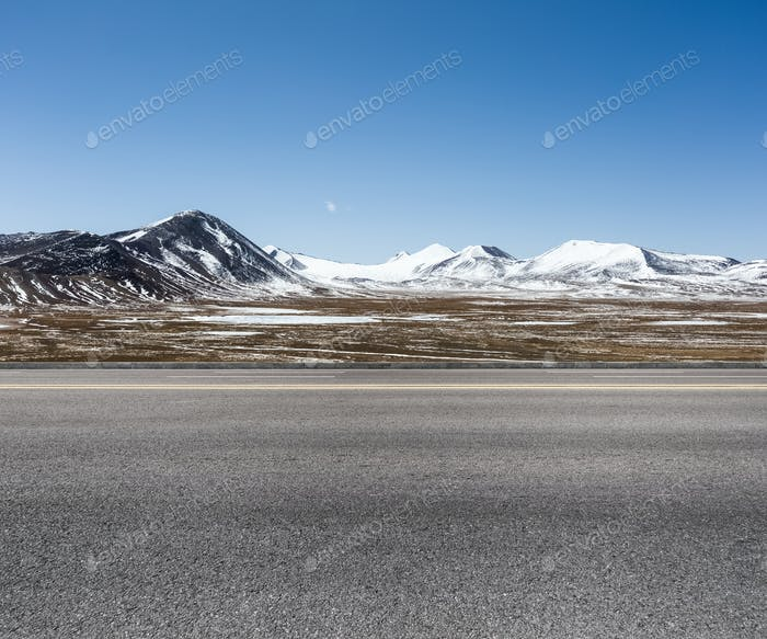 empty road on snow area plateau