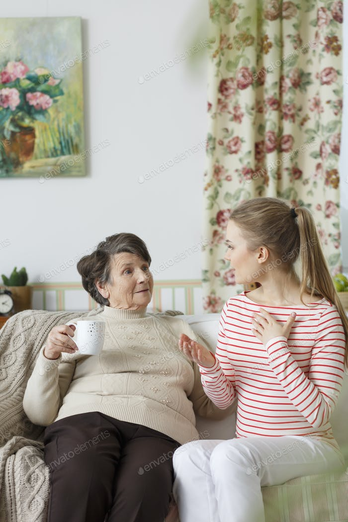 Grandma talking to her grandchild