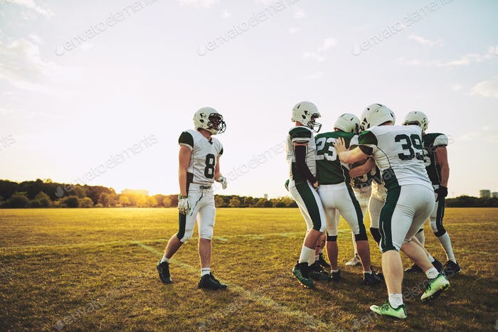 Young American football players having fun together during practice
