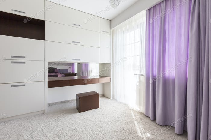Purple curtains in the bedroom