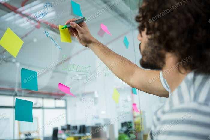 Executive writing on sticky notes