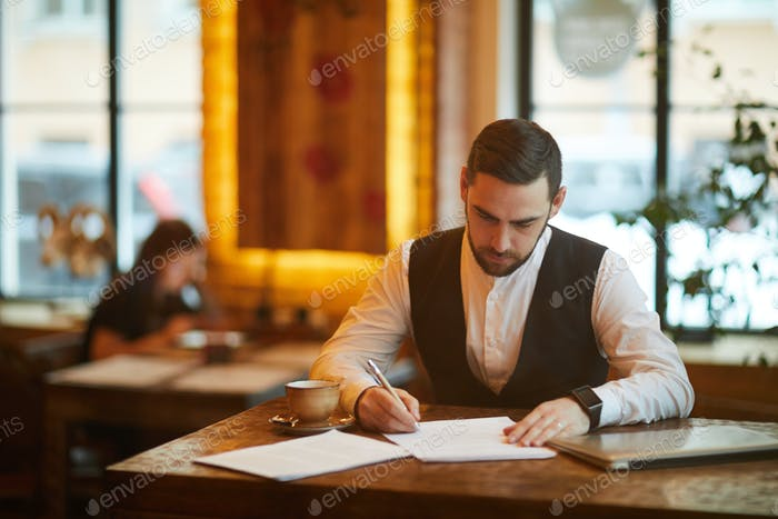 Busy Businessman in Cafe