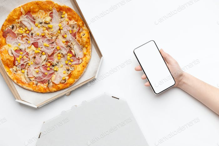 Order food online. Pizza in cardboard box, top view