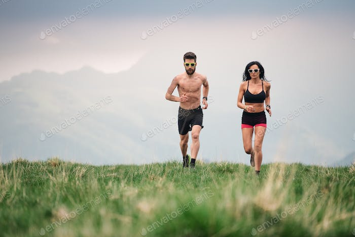 Sporty man and woman run