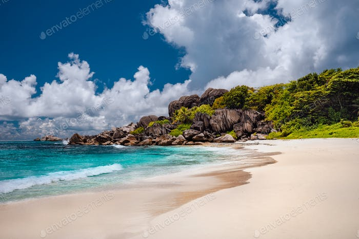 Grand anse sandy beach with azure ocean lagoon, La Digue island, Seychelles
