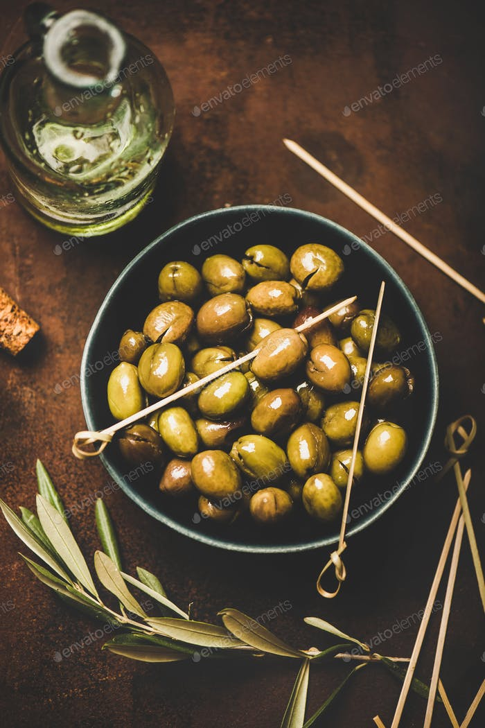 Flat-lay of fresh harvested seasonal pickled green Mediterranean olives