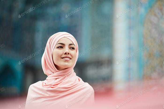 Confident young Arabian lady in silk hijab