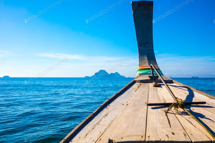 Longtail Boat In Sea At Aonang Beach Against Blue Sky
