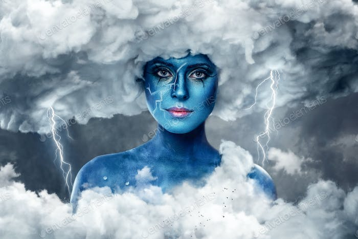 Female with blue skin in an arch of white clouds.