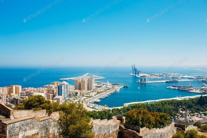 Cityscape Of Malaga, Spain. Residential Houses And Port
