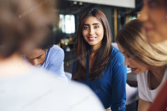 Portrait of beautiful Asian woman over work