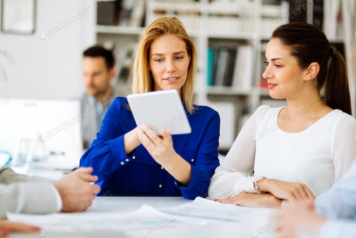 Group of business people working as team in office