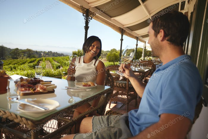 Couple drinking wine at winery restaurant