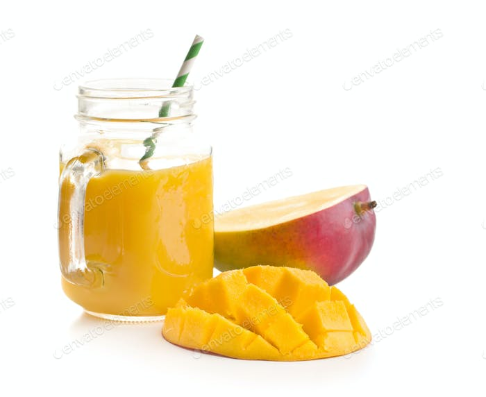 Ripe mango fruit and mango juice.