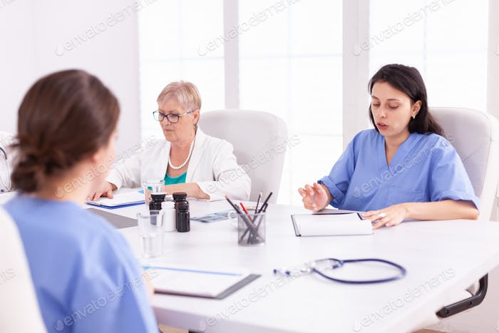 Healthcare workers having a meeting