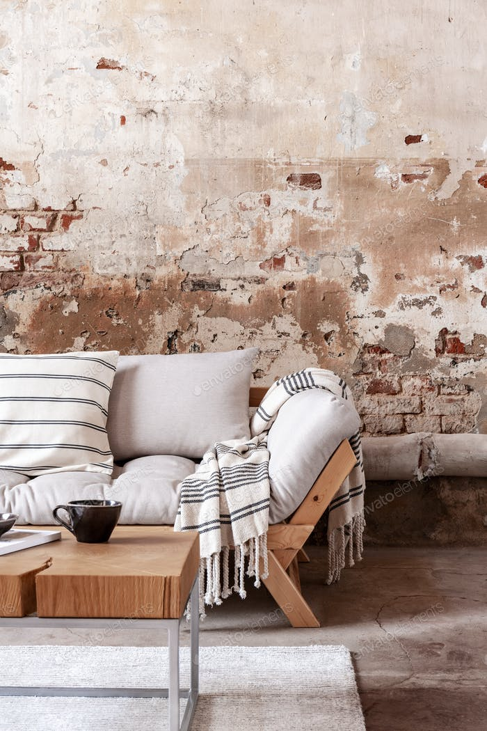 Wooden Table In Front Of Grey Couch With Blanket In Wabi Sabi Li Photo By Bialasiewicz On Envato Elements