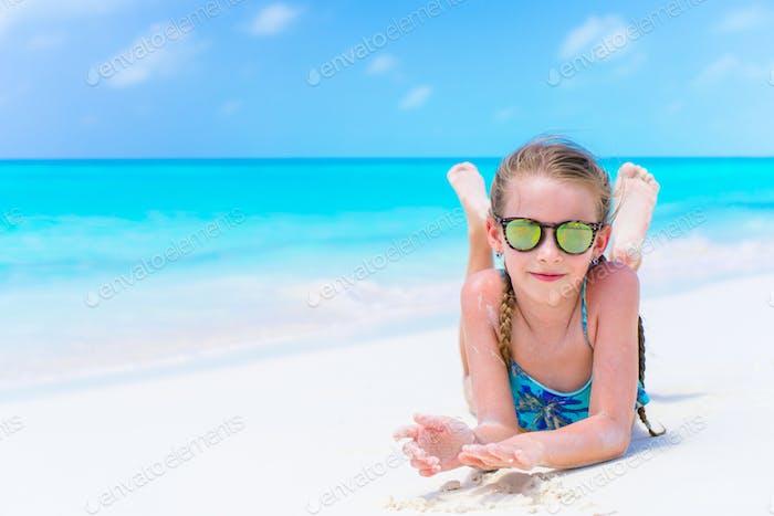 Little cute girl on the seashore enjoy beach holiday